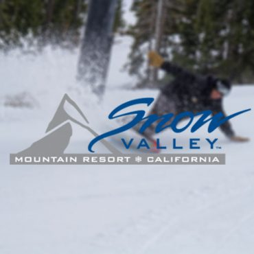 Snow Valley Mountain Resort logo laid over blurred image of snowboarder